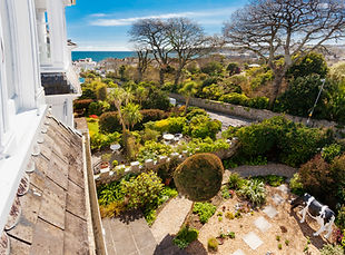 Stunning views over the gardens and out to sea at Myrtle House Penzance