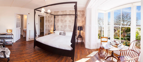 Master Bedroom Suite at Myrtle House Penzance - four poster bed framed with Timorous Beasties wallpaper