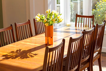 Sunlight floods into the formal Dining Room seating 10 at Myrtle House Penzance