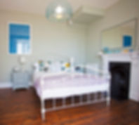 Period fireplaces and designer pieces mix in the Blue Bedroom at Myrtle House Penzance