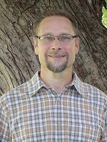 Travis headshot website.jpg