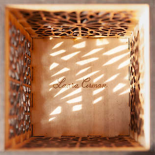 A lasercut box with a design based on a traditional, Islamic pattern.  Inside view.