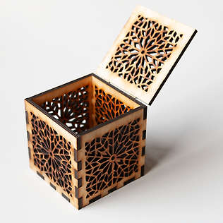 A lasercut box with a design based on a traditional, Islamic pattern.