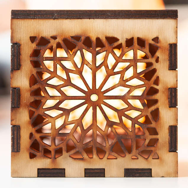 A lasercut box with a design based on a traditional, Islamic pattern.  Side view.