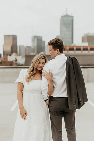 Bride and Groom taking engagement pictures with Reib Photography