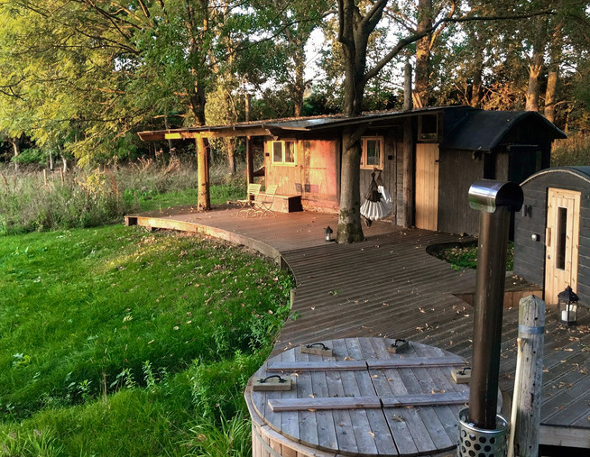 rustic wooden cabin woodfired hot tub ec