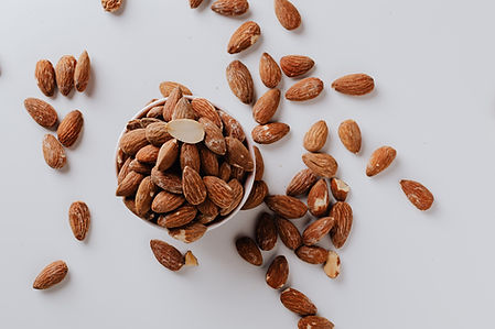 bowl-filled-with-raw-almond-nuts-on-whit