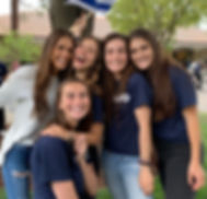 Five smiling female college students at the Israel birthday celebration on campus