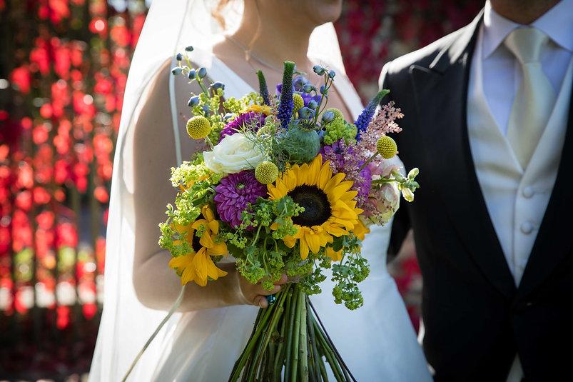 Sunflower and cream rose bouquet