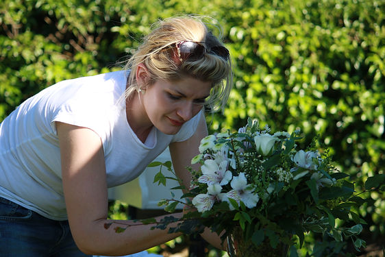 Harriet May Working on a bouquet