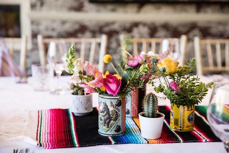 Pink Rose and Antirrhinum table arrangements