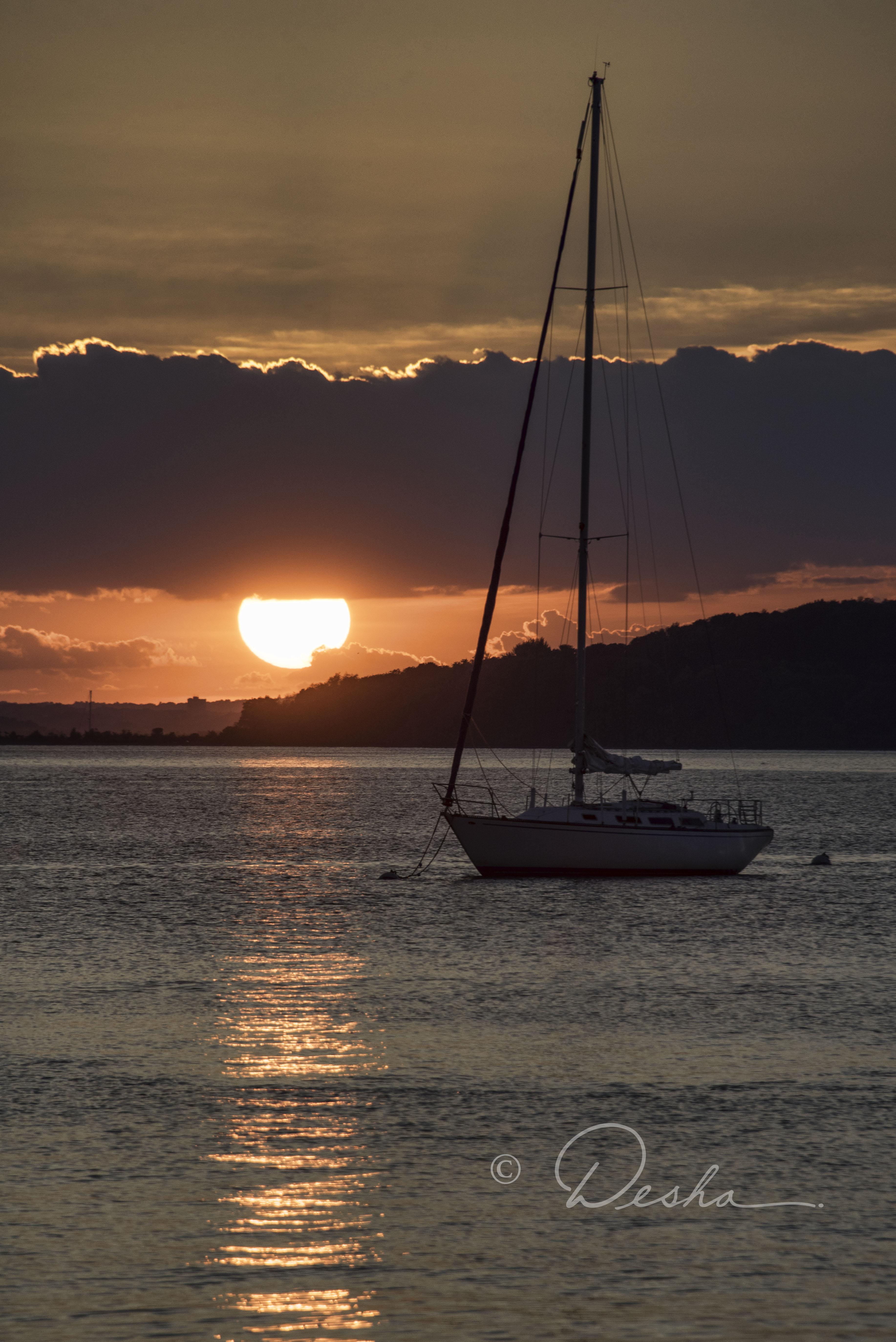 Sailboat & Sun in Hull