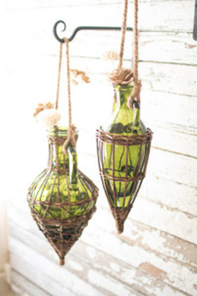 Set of hanging green glass & wicker wrapped vases