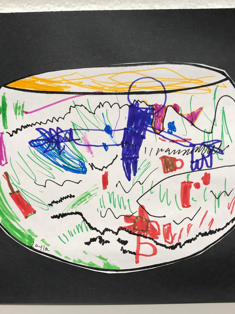 A round pot evidences depth and decorative detailing.