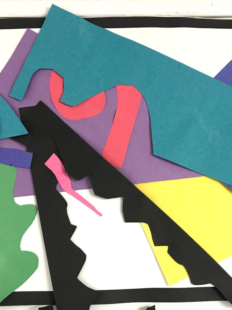 Hand-cut geometric shapes create visual intrigue, per the Matisse method.