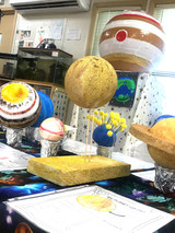 Might we mention that Art powers STEAM? These gorgeous planets, created by Kindergartners in their study of space, is but one example of how color, proportion, and form propel the scientists of tomorrow.