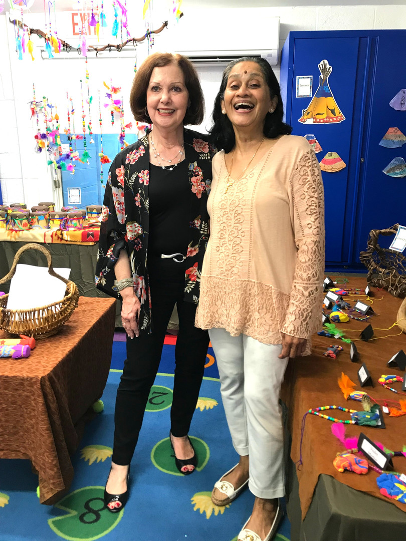 Art Specialist, Mrs. Korb, with Art Assistant Mrs. Joseph. . . Applause for these kind hands, warm hearts, and amazing eyes!