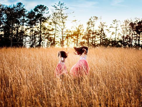 both-girls-tall-grass.jpg