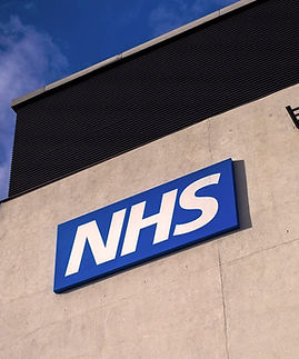 nhs-warrington-2016-outside-with-picture-of-nhs-sign.jfif