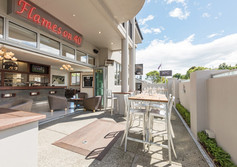 Relax in the sunny courtyard or cosy up in front of the fire at Nelson's Flames on Forty Restaurant and Bar.