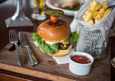 Enjoy a Beef Burger with fries at Nelson's Flames on Forty Restaurant and Bar.