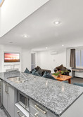 Kitchen island and lounge of four-bedroom apartment