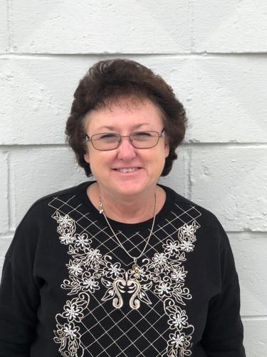 Loretta Carwle, Receptionist