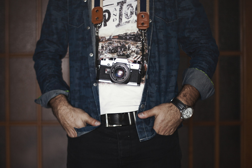 Jeans, t-shirt and shirt with sleeves rolled up