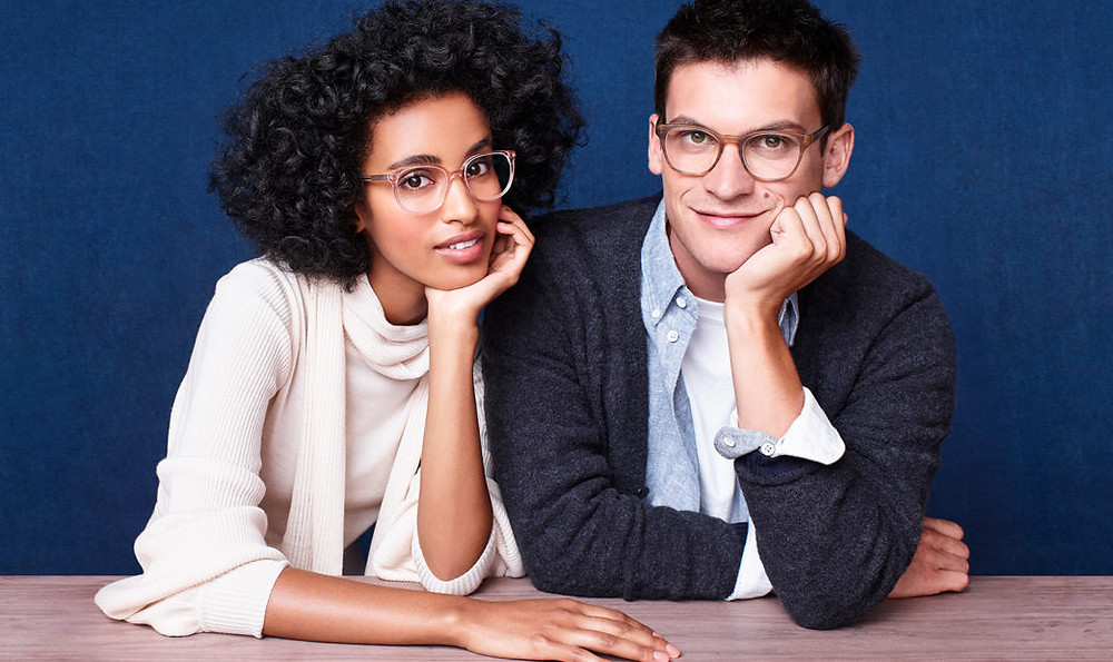 man and woman wearing glasses