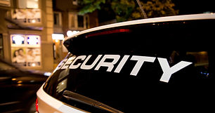 Security vehicle patrolling city at nigh