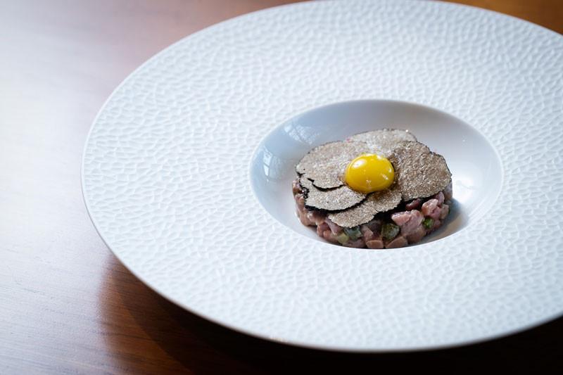 Coa - Ritz Reserve - Prime Tenderloin Tartare with dijon mustard, black truffles, quail yolk and tostones