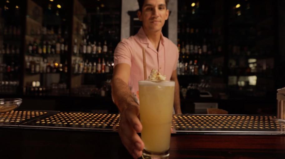 Bartender in House, Malibu Fizz.