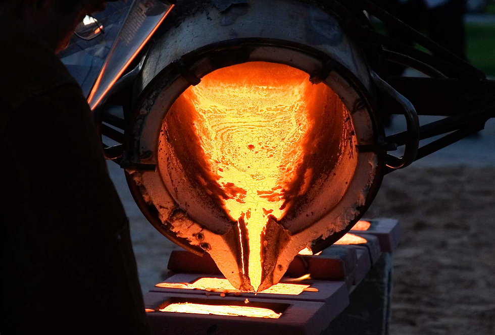 A ferrous foundry ladle pouring various grades of stainless steel.