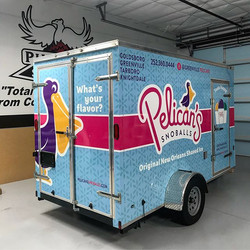 Check out the transformation on this trailer! Full trailer wrap done for pelicans snowballs! Call us