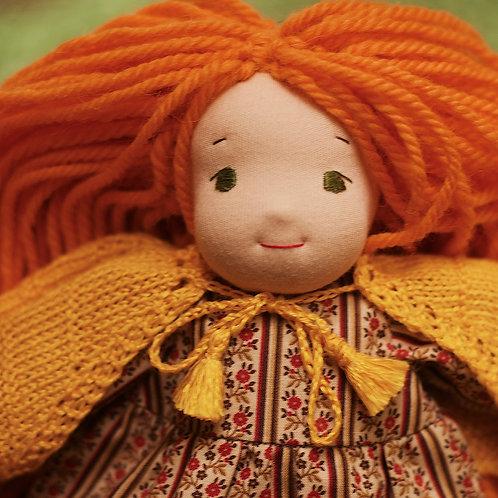 Рыжая девочка в оранжевом пончо