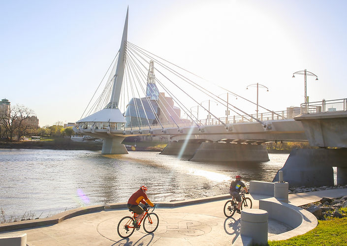 Cyclists along Red River in a sunny day, Winnipeg - Canada .jpg