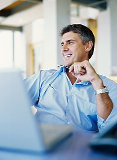 man viewing pc screen showing finances