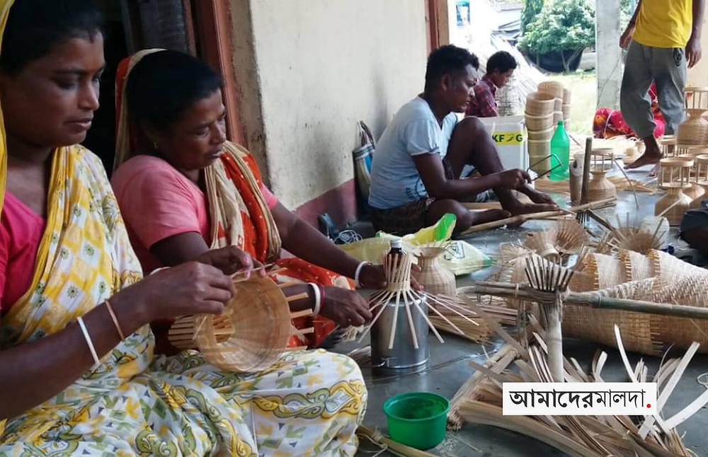 No work in hands of bamboo craftsmen of Gazole Majlishbag