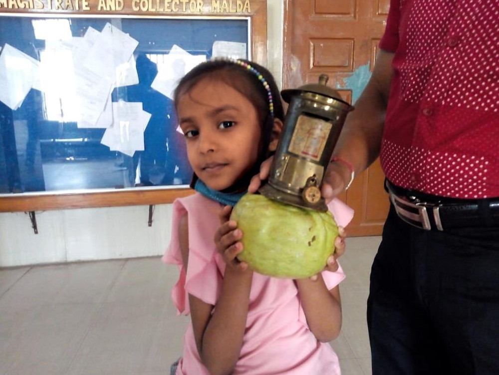Girl donates piggy bank for Chief Minister Emergency Fund