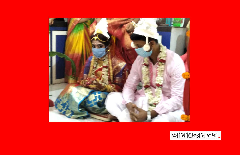 Lockdown newlyweds wear mask in Malda