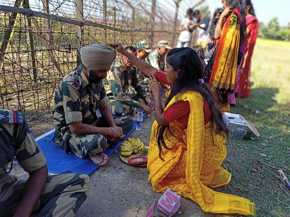 Malda girls applying tilak on the foreheads of BSF jawans