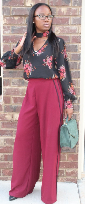 Floral Business Attire accompanied by burgundy Flare Pants with a hence of black stripes.