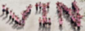 Nepalese schoolchildren forming the acronym 'VIN'