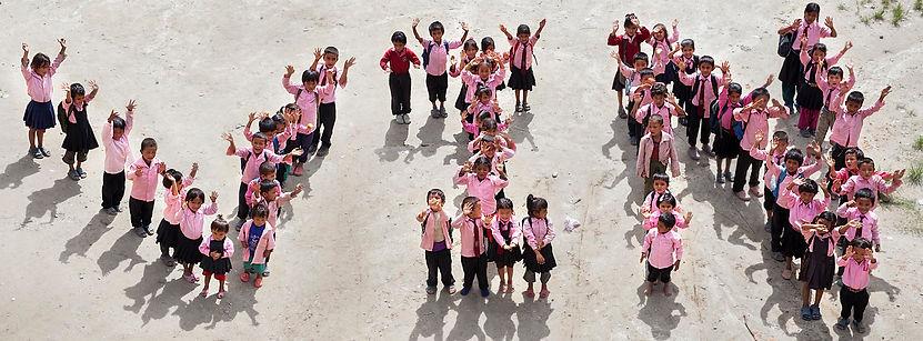 School children spelling out VIN (Volunteers Initiative Nepal)