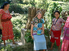 Dee Chapon, VIN volunteer, trying to carry heavy load traditionally carried by Nepalese women