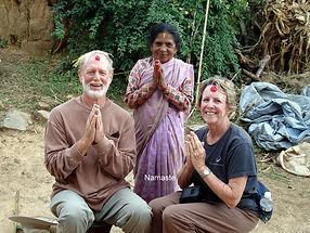 "Mature age volunteers receiving ""tikka"" during Hindu celebration in Nepal"