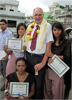 Boomer Volunteer with Nepalese students