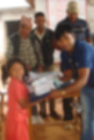 Sponsored girl receiving package from VIN staff