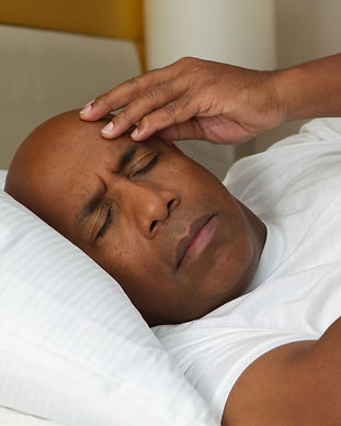 African American man having trouble slee