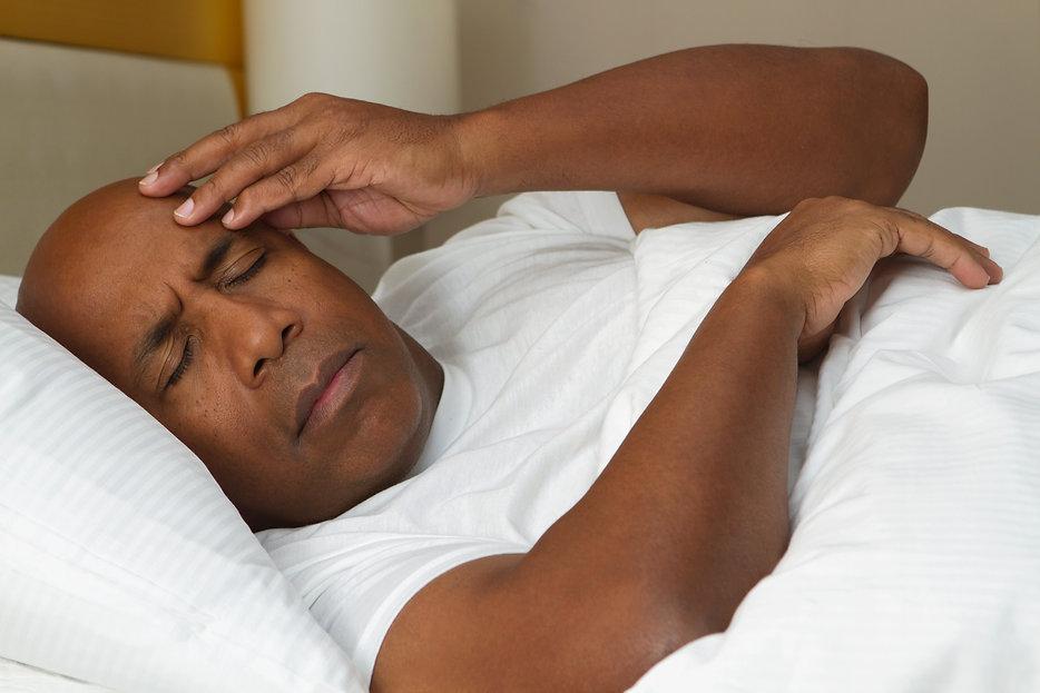African American man having trouble slee